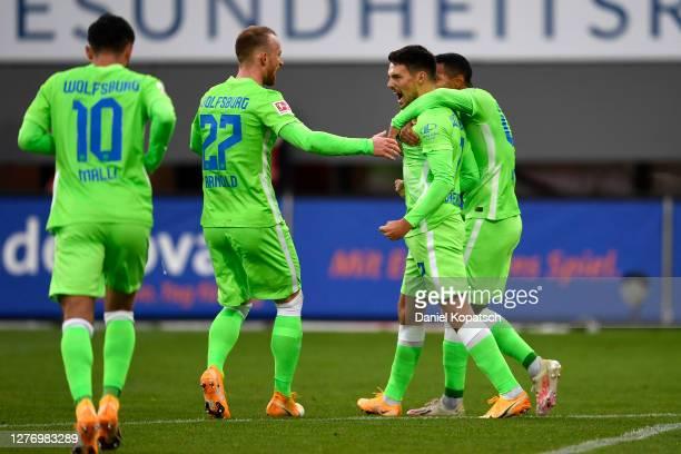 Josip Brekalo of VfL Wolfsburg celebrates after scoring his sides first goal during the Bundesliga match between Sport-Club Freiburg and VfL...