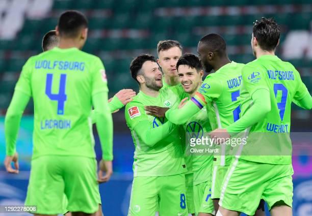 Josip Brekalo of VfL Wolfsburg celebrates with Renato Steffen, Josuha Guilavogui and Wout Weghorst after scoring their team's first goal during the...