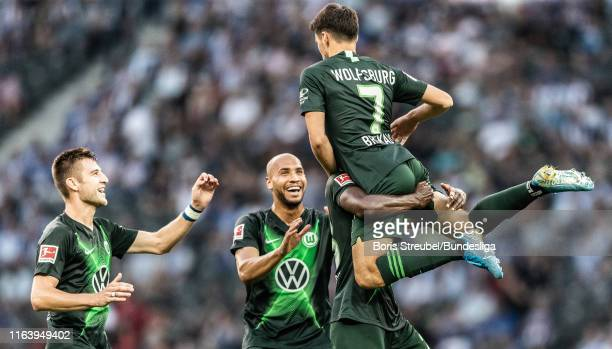 Josip Brekalo of VfL Wolfsburg celebrates with team mates after scoring his team's second goal during the Bundesliga match between Hertha BSC and VfL...