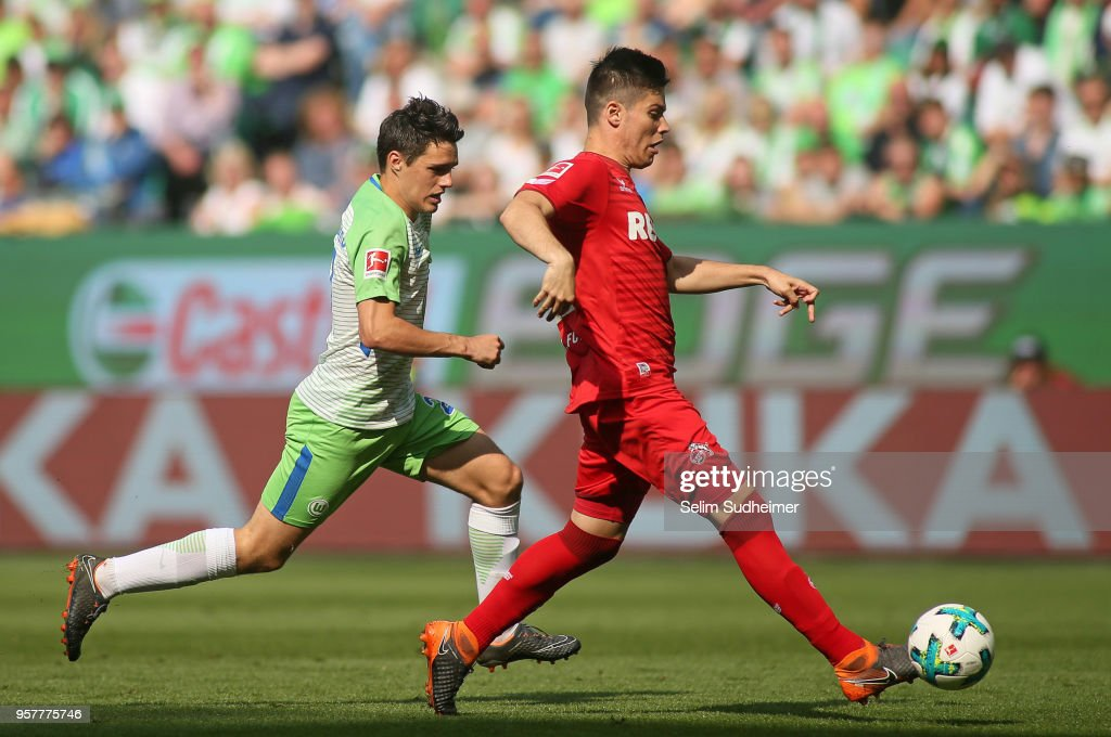 Josip Brekalo of Wolfsburg (L) fights for the ball with Jorge Mere of Koeln during the Bundesliga match between VfL Wolfsburg and 1. FC Koeln at Volkswagen Arena on May 12, 2018 in Wolfsburg, Germany.