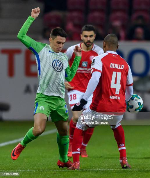 Josip Brekalo of Wolfsburg in action against Abdou Diallo of Mainz during the Bundesliga match between 1 FSV Mainz 05 and VfL Wolfsburg at Opel Arena...