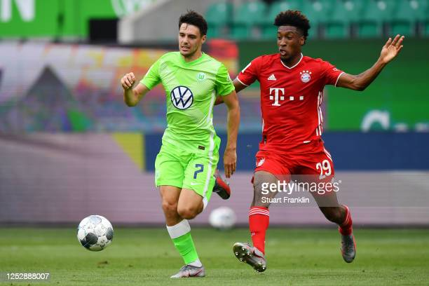 Josip Brekalo of Wolfsburg is challenged by Kingsley Coman of Muenchen during the Bundesliga match between VfL Wolfsburg and FC Bayern Muenchen at...