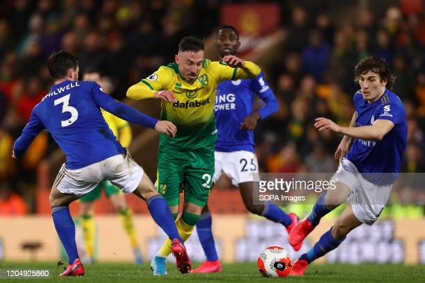 Josip Drmic Ben Chilwell and Caglar Soyuncu in action during the Premier League match between Norwich City and Leicester City at Carrow Road Final...
