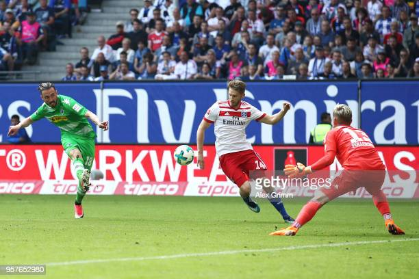 Josip Drmic of Borussia Moenchengladbach scores his sides first goal during the Bundesliga match between Hamburger SV and Borussia Moenchengladbach...