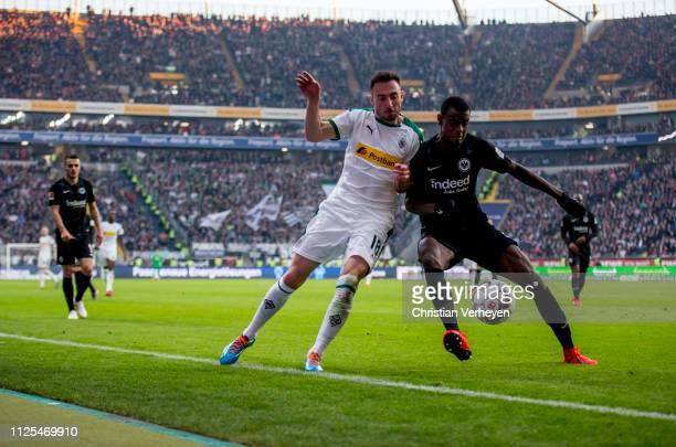 Josip Drmic of Borussia Moenchengladbachand Evan N'Dicka of Eintracht Frankfurt battle for the ball during the Bundesliga match between Eintracht...