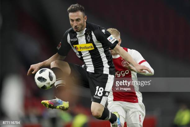 Josip Drmic of Borussia Monchengladbach Donny van de Beek of Ajax during the international friendly match between Ajax Amsterdam and Borussia...