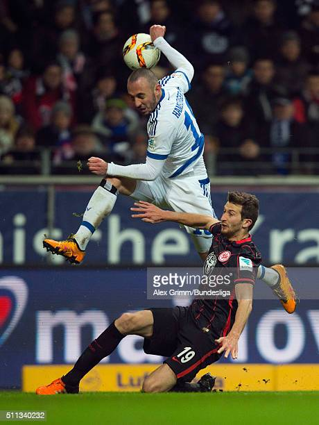 Josip Drmic of Hamburg is challenged by David Abraham of Frankfurt during the Bundesliga match between Eintracht Frankfurt and Hamburger SV at...