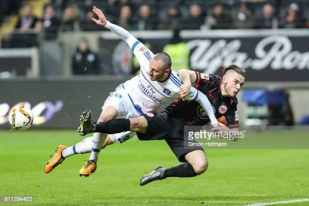 Josip Drmic of Hamburg is challenged by Yanni Regaesel of Frankfurt during the Bundesliga match between Eintracht Frankfurt and Hamburger SV at...