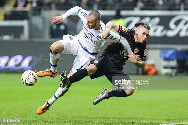 Josip Drmic of Hamburg is challenged by Yanni Regaesel of Frankfurt during the Bundesliga match between Eintracht Frankfurt and Hamburger SV at...