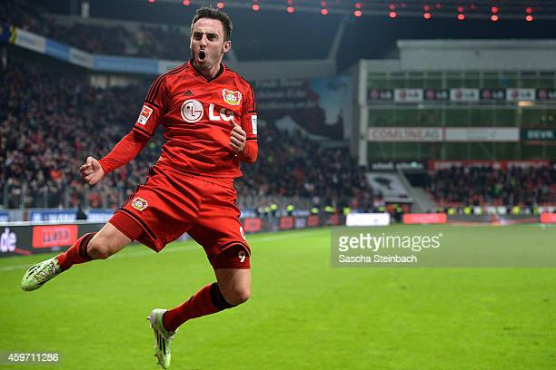 Josip Drmic of Leverkusen celebrates after scoring his team's fourth goal during the Bundesliga match between Bayer 04 Leverkusen and 1 FC Koeln at...