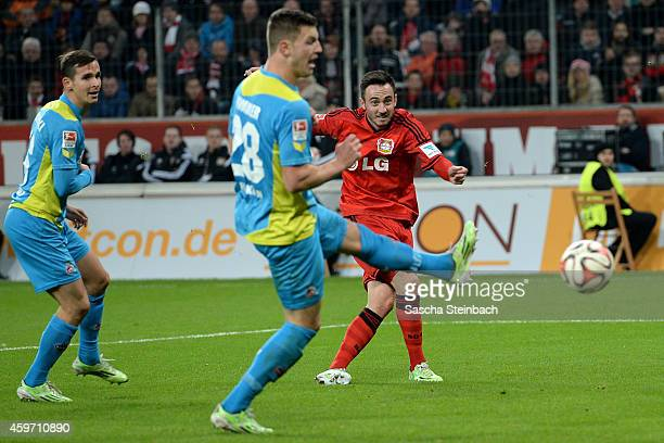 Josip Drmic of Leverkusen scores his team's third goal during the Bundesliga match between Bayer 04 Leverkusen and 1 FC Koeln at BayArena on November...