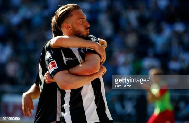 Josip Drmic of Moenchengladbach celebrates after scoring his teams third goal during the Bundesliga match between Borussia Moenchengladbach and...