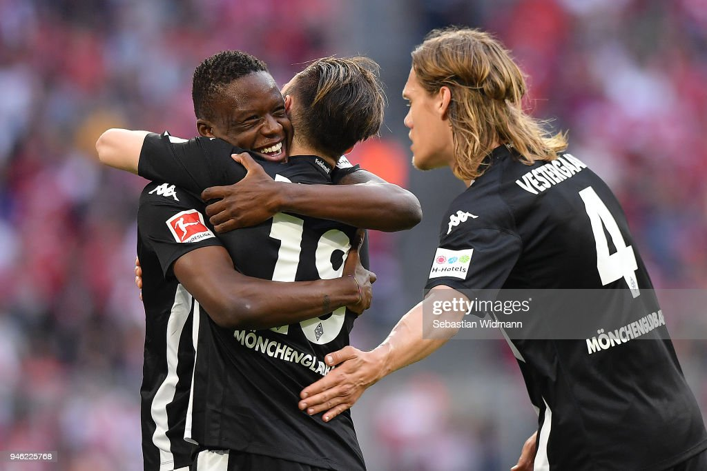 Josip Drmic of Moenchengladbach (c) celebrates with Denis Zakaria of Moenchengladbach (l) and Jannik Vestergaard of Moenchengladbach after he scored a goal to make it 0:1 during the Bundesliga match between FC Bayern Muenchen and Borussia Moenchengladbach at Allianz Arena on April 14, 2018 in Munich, Germany.