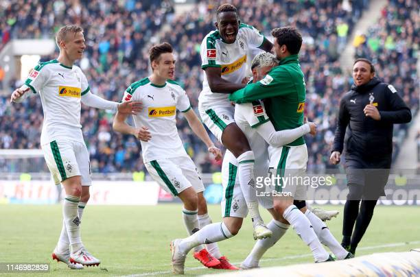 Josip Drmic of Moenchengladbach celebrates with team mates after scoring his teams second goal during the Bundesliga match between Borussia...