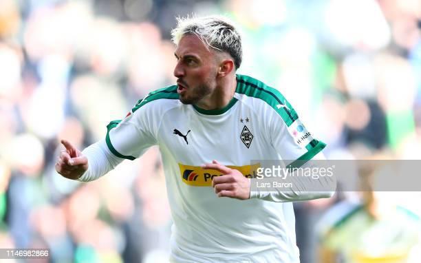 Josip Drmic of Moenchengladbach celebrates with team mates after scoring his teams second goal during the Bundesliga match between Borussia...