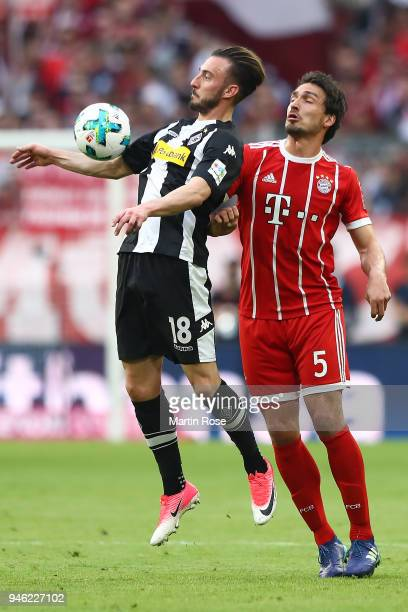 Josip Drmic of Moenchengladbach fights for the ball with Mats Hummels of Bayern Muenchen during the Bundesliga match between FC Bayern Muenchen and...