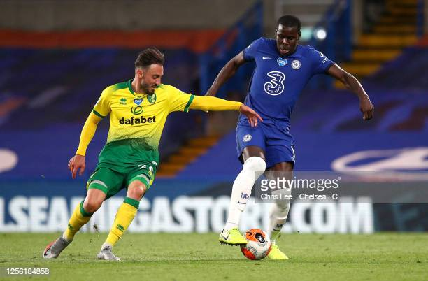 Josip Drmic of Norwich City and Kurt Zouma of Chelsea challenge for the ball during the Premier League match between Chelsea FC and Norwich City at...