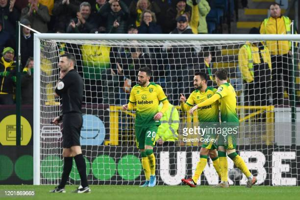 Josip Drmic of Norwich City celebrates with teammates after scoring his team's second goal during the FA Cup Fourth Round match between Burnley FC...