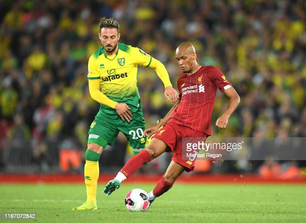 Josip Drmic of Norwich City closes down Fabinho of Liverpool during the Premier League match between Liverpool FC and Norwich City at Anfield on...