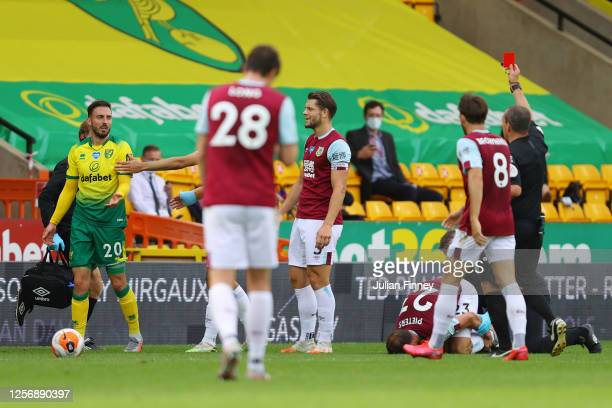 Josip Drmic of Norwich City is shown a red card by Match Referee, Kevin Friend during the Premier League match between Norwich City and Burnley FC at...