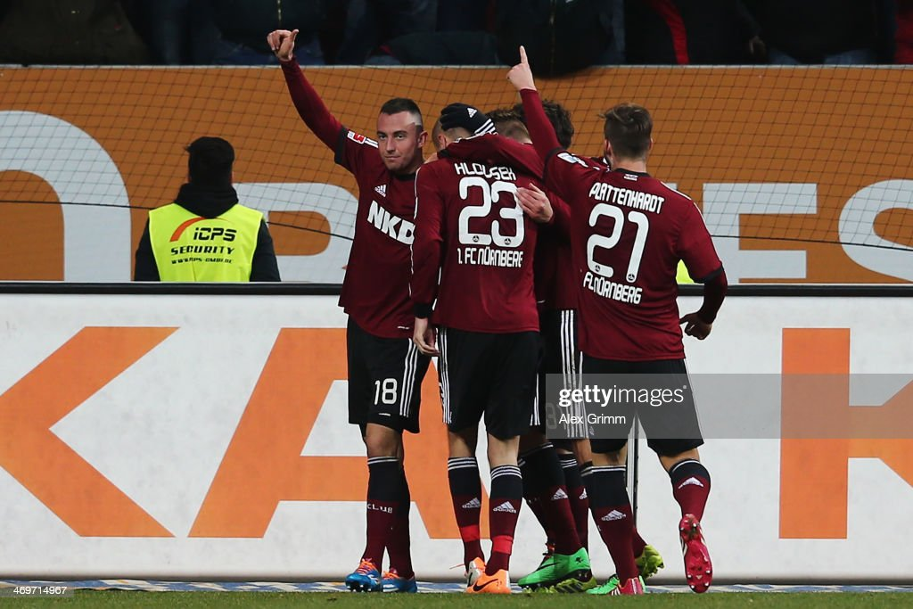 Josip Drmic (L) of Nuernberg celebrates his team's first goal with team mates during the Bundesliga match between FC Augsburg and 1. FC Nuernberg at SGL Arena on February 16, 2014 in Augsburg, Germany.