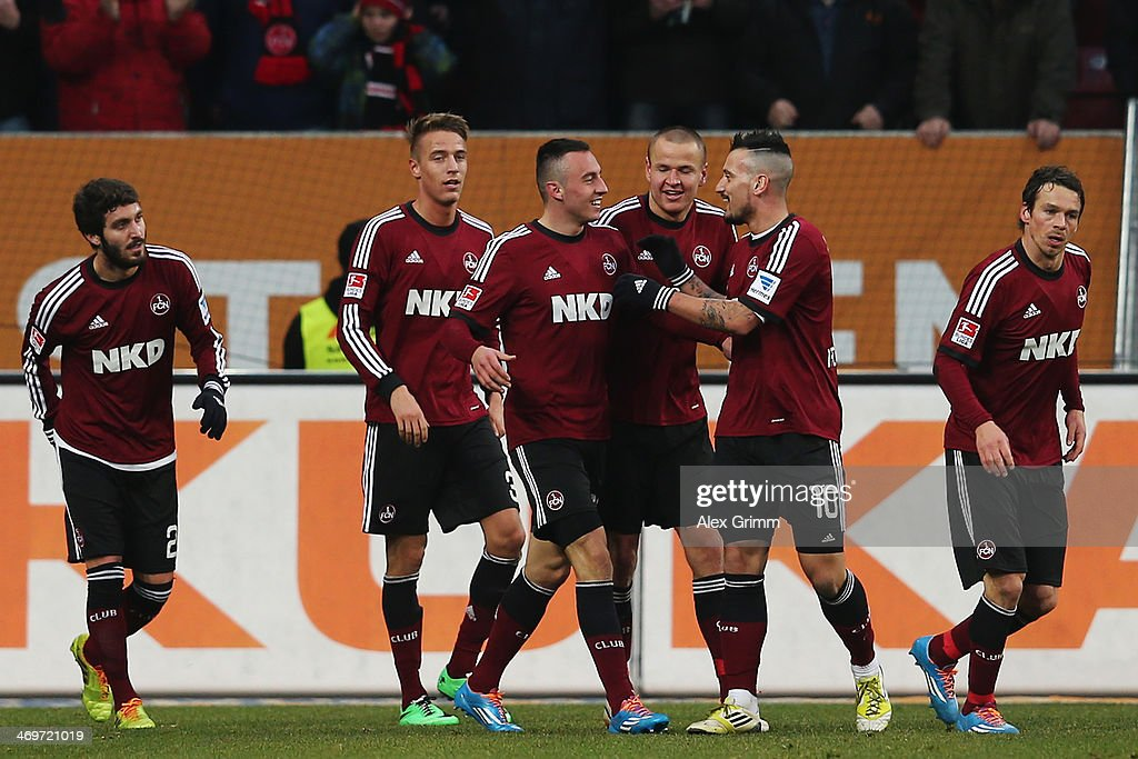 Josip Drmic (3L) of Nuernberg celebrates his team's first goal with team mates during the Bundesliga match between FC Augsburg and 1. FC Nuernberg at SGL Arena on February 16, 2014 in Augsburg, Germany.