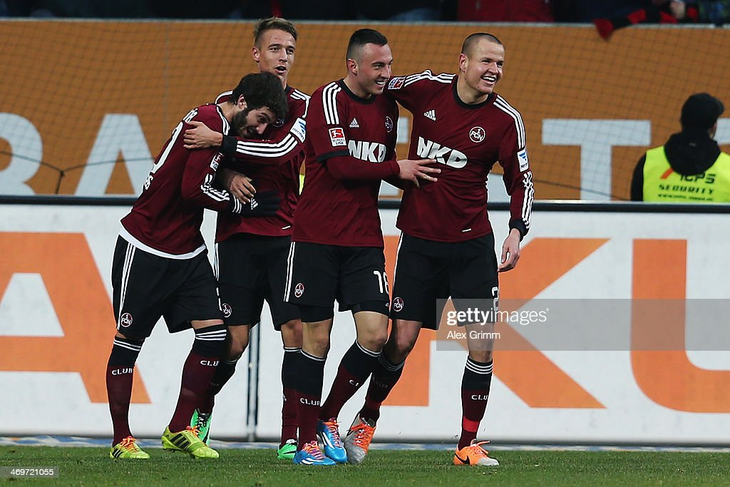 Josip Drmic (2R) of Nuernberg celebrates his team's first goal with team mates during the Bundesliga match between FC Augsburg and 1. FC Nuernberg at SGL Arena on February 16, 2014 in Augsburg, Germany.
