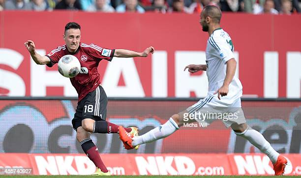 Josip Drmic of Nuernberg is challenged by Oemer Toprak of Leverkusen during the Bundesliga match between 1 FC Nuernberg and Bayer Leverkusen at...