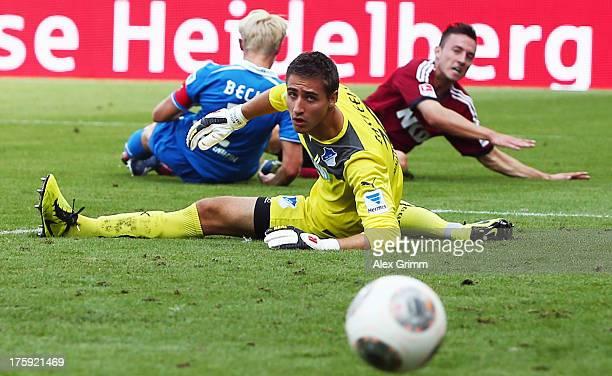 Josip Drmic of Nuernberg tries to score against Andreas Beck and goalkeeper Koen Casteels of Hoffenheim during the Bundesliga match between 1899...