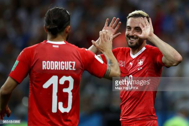Josip Drmic of Switzerland celebrates with teammate Ricardo Rodriguez after scoring his team's second goal during the 2018 FIFA World Cup Russia...
