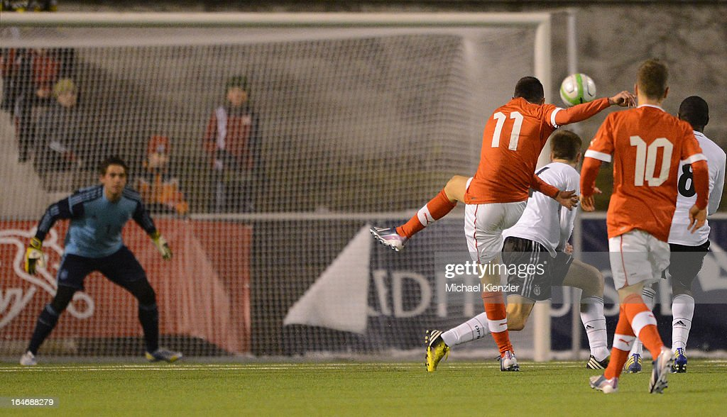 Josip Drmic (L) of Switzerlandscores the second goal during the international friendly match between U20 Switzerland and U20 Germany at Eps Stadium on March 26, 2013 in Baden, Switzerland