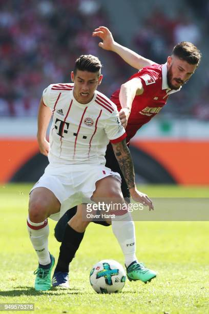Josip Elez of Hannover and James Rodriguez of Munich compete for the ball during the Bundesliga match between Hannover 96 and FC Bayern Muenchen at...