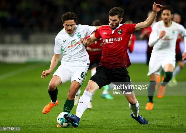 Josip Elez of Hannover and Thomas Delaney of Bremen battle for the ball during the Bundesliga match between Hannover 96 and SV Werder Bremen at...