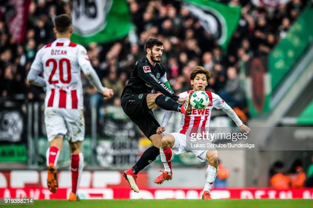 Josip Elez of Hanover and Yuya Osako of Koeln in action during the Bundesliga match between 1 FC Koeln and Hannover 96 at RheinEnergieStadion on...