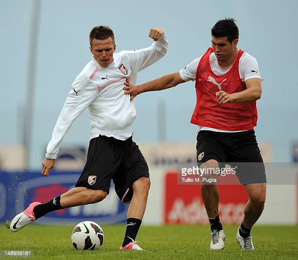 Josip Ilicic and Ezequiel Munoz in action during a US Citta di Palermo preseason training session at Sport Well Center on July 20 2012 in Malles...
