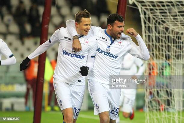 Josip Ilicic celebrates after scoring with Andrea Petagna during the Serie A football match between Torino FC and Atalanta Bergamasca Calcio at...