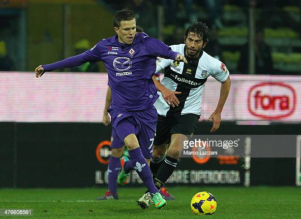 Josip Ilicic of ACF Fiorentina competes with Gianni Munari of Parma FC during the Serie A match between Parma FC and ACF Fiorentina at Stadio Ennio...