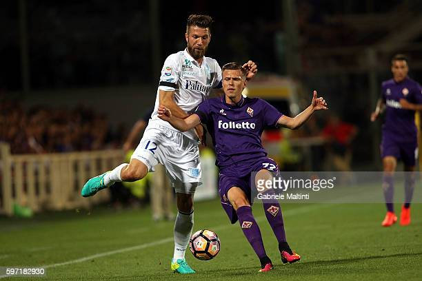 Josip Ilicic of ACF Fiorentina fights for the ball with Cesar Bostjan of AC Chievo Verona during the Serie A match between ACF Fiorentina and AC...