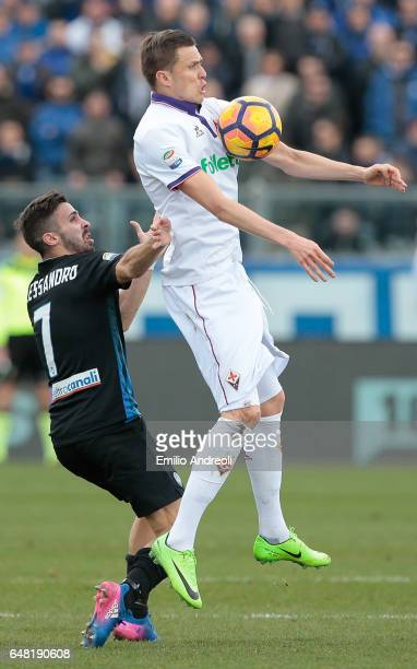 Josip Ilicic of ACF Fiorentina jumps for the ball with Marco D Alessandro of Atalanta BC during the Serie A match between Atalanta BC and ACF...