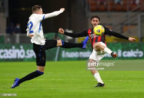 Josip Ilicic of Atalanta and Davide Calabria of AC Milan battle for possession during the Serie A match between AC Milan and Atalanta BC at Stadio...
