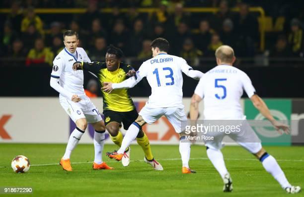 Josip Ilicic of Atalanta and Mattia Caldara of Atalanta try to stop Michy Batshuayi of Borussia Dortmund reacts during UEFA Europa League Round of 32...
