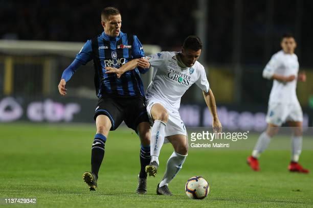 Josip Ilicic of Atalanta Bc battles for the ball with Manuel Pasqual of Empoli FC during the Serie A match between Atalanta BC and Empoli at Stadio...