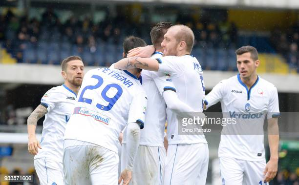 Josip Ilicic of Atalanta BC celebrates after scoring his ream's third goal goal during the serie A match between Hellas Verona FC and Atalanta BC at...