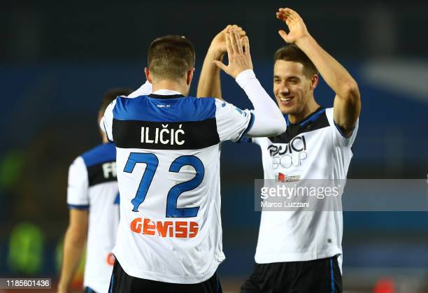 Josip Ilicic of Atalanta BC celebrates after scoring the third goal of his team with his teammate Mario Pasalic during the Serie A match between...