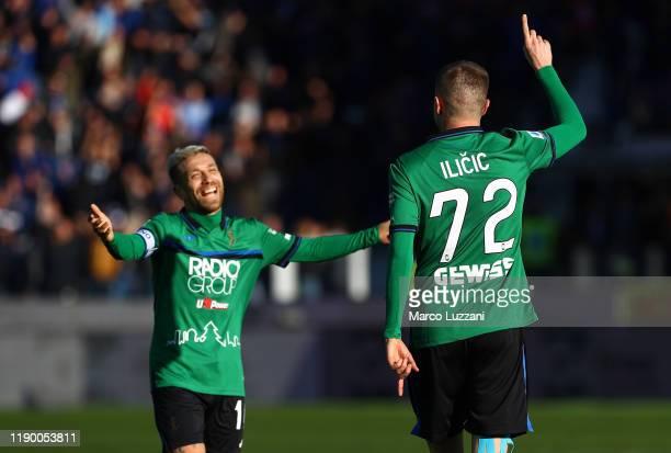 Josip Ilicic of Atalanta BC celebrates his second goal with his team mate Alejandro Dario Gomez during the Serie A match between Atalanta BC and AC...