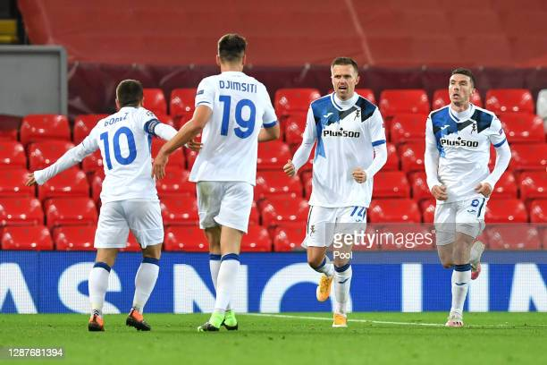 Josip Ilicic of Atalanta B.C. Celebrates with Alejandro Gomez, Robin Gosens and Berat Djimsiti after scoring their team's first goal during the UEFA...