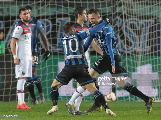 Josip Ilicic of Atalanta BC celebrates with his teammate Alejandro Gomez after scoring the opening goal during the Serie A match between Atalanta BC...