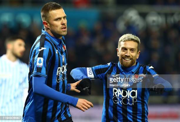 Josip Ilicic of Atalanta BC celebrates with his teammate Alejandro Dario Gomez after scoring the opening goal during the Serie A match between...