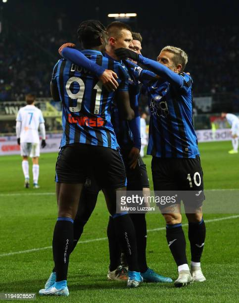 Josip Ilicic of Atalanta BC celebrates with his teammates after scoring the opening goal Duvan Zapata and Alejandro Dario Gomez during the Serie A...