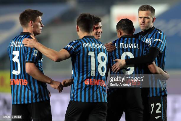 Josip Ilicic of Atalanta BC celebrateswith team mate Luis Muriel after scoring their team's fourth goal during the Serie A match between Atalanta BC...